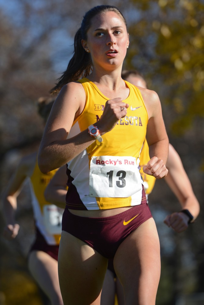Graduate student Carli Schulz runs at Rocky