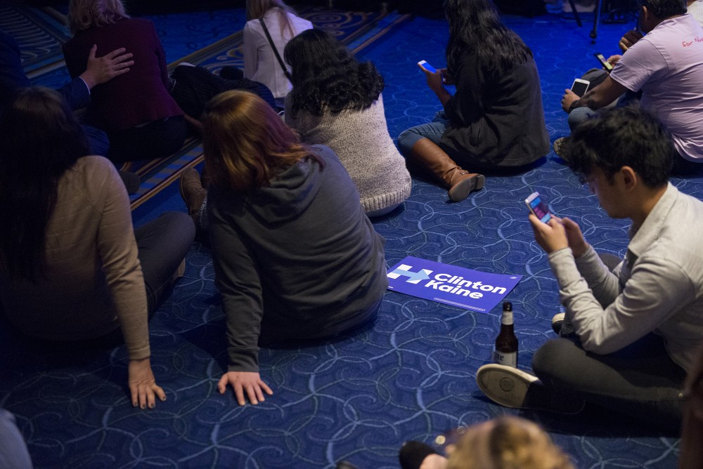 Attendees sit on the ground as they watch election results roll in at the Minnesota DFL election night party at the Minneapolis Hilton on Tuesday, Nov. 8, 2016.