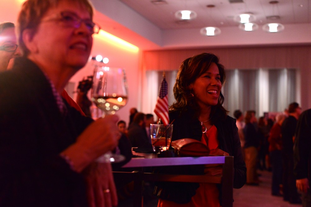Barb Kampmeier, left, and Eva Norman, right, watch election results come in at the Republican Party of Minnesota's Victory Party at the Radisson Blue Mall of America in Bloomington on Nov. 8, 2016.