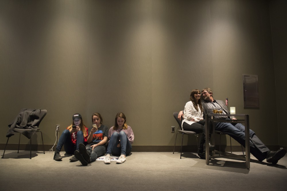 High schoolers Maddy Paja, Mackenzie Bolduc and Marissa Bolduc, and Laura and Cliff Schutter sit and wait for the election to be called at the Republican Party of Minnesota's Victory Party at the Radisson Blu Mall of America in Bloomington, MN on Nov. 8, 2016.