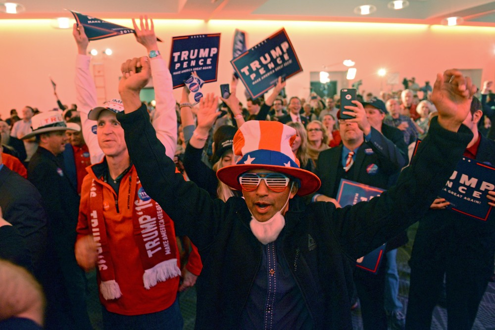 Preston Rodrigues celebrates as another state is called for Donald Trump on Tuesday, Nov. 8, 2016 at the Radisson Blue Mall of America in Bloomington.