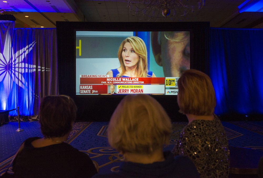 Women watch as results for others states roll in at the Minnesota DFL election night party at the Minneapolis Hilton on Tuesday, Nov. 8, 2016.