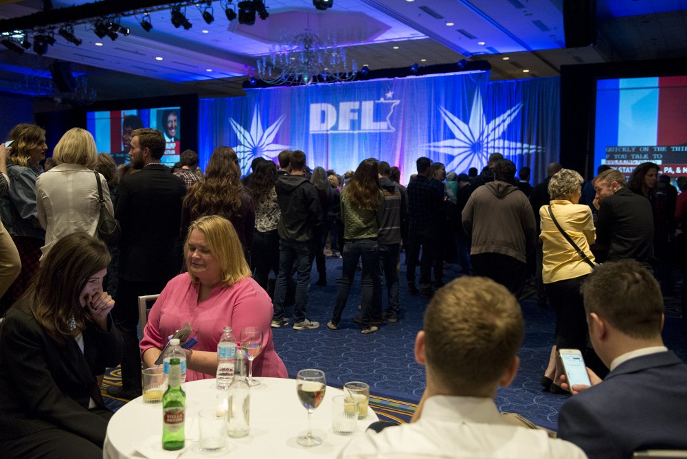 Astrid Sandell right, shows Kristin Helgeson, left, polling results on Tuesday, Nov. 8, 2016 at the Minnesota DFL election night party at the Minneapolis Hilton.