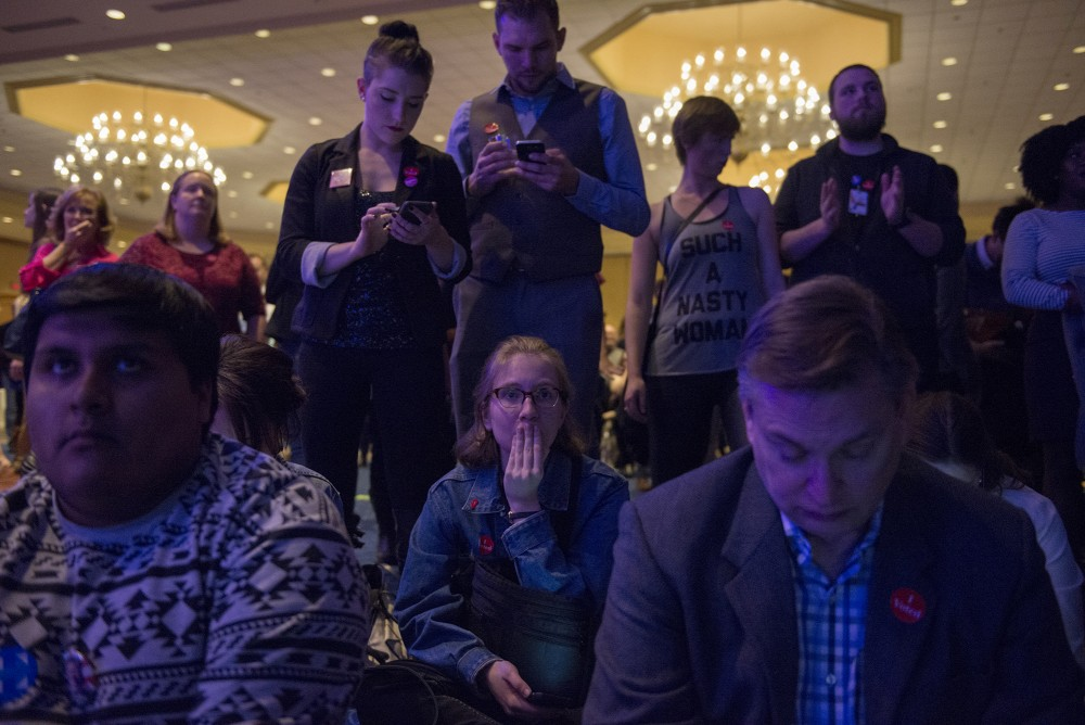 Macalester College sophomore Elizabeth Loetscher, center, covers her mouth as she nervously watching results roll in at the Minnesota DFL election night party at the Minneapolis Hilton on Tuesday, Nov. 8, 2016.