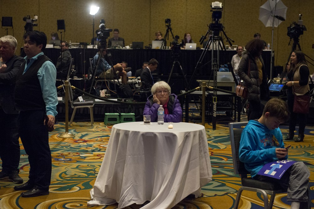 Barbara Saunders watches polling results roll in at the Minnesota DFL election night party at the Minneapolis Hilton on Tuesday, Nov. 8, 2016.