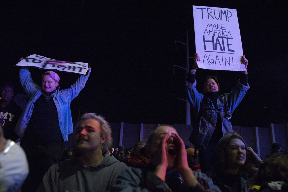 Participants chant on interstate 94 in Minneapolis during an anti-trump protest on Thursday, Nov. 10, 2016.