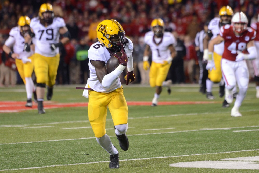 Gophers wide receiver Tyler Johnson runs the ball down the field against the Cornhuskers at Memorial Stadium in Lincoln, Nebraska on Saturday, Nov. 12, 2016.