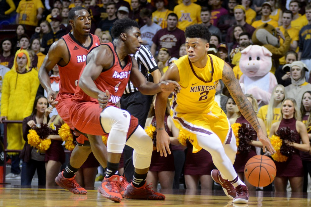 Junior guard Nate Mason runs the ball up the court on Friday at Williams Arena. The Gophers would go on to win 86-74 against the Ragin' Cajuns.