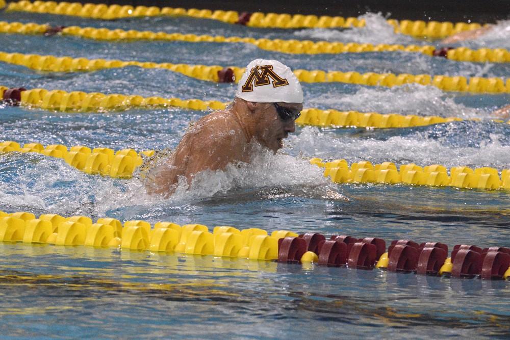 John Bushmann swims the 100-yard breaststroke at the Minnesota Invite on Friday, Nov. 11, 2016 at the Jean K. Freeman Aquatic Center.