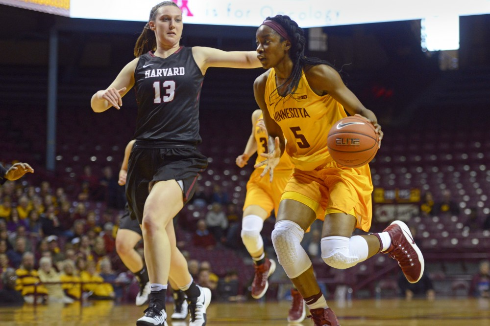 Gophers forward Taiye Bello handles the ball at Williams Arena on Nov. 12, 2016. The Gophers beat Harvard University 103-87 in their season opener.