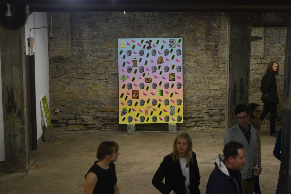 Attendees view paintings by Mathew Zefeldt during his gallery opening on Nov. 12, 2016 at the Soap Factory in Minneapolis .