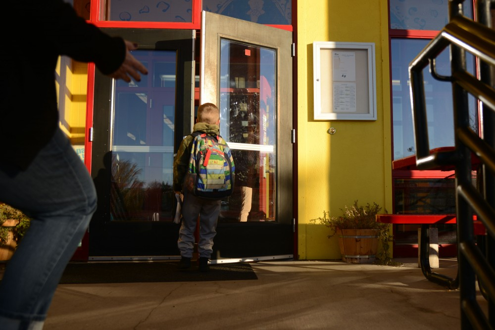 Asher Caslow, 6, walks into school with his mom, Amy Caslow in St. Paul on Wednesday, Nov. 16, 2016. Asher is in his fourth year at Metro Deaf School, a public charter school that serves students who are primarily deaf, deaf-blind, and hard-of-hearing, where he learns American Sign Language and English.