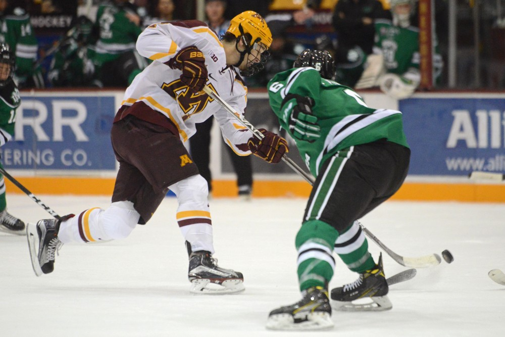 Gophers forward Tommy Novak sneaks the puck around North Dakota on Friday, Nov. 4, 2016 at Mariucci Arena.