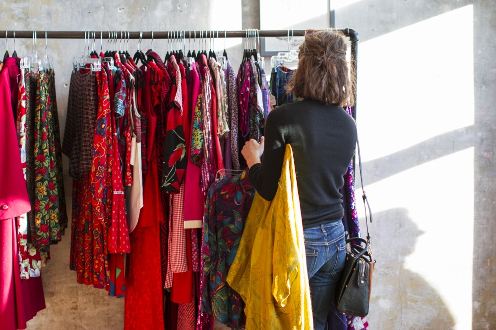 Clothing hangs on the racks during a recent pop-up event by Moth Oddities.