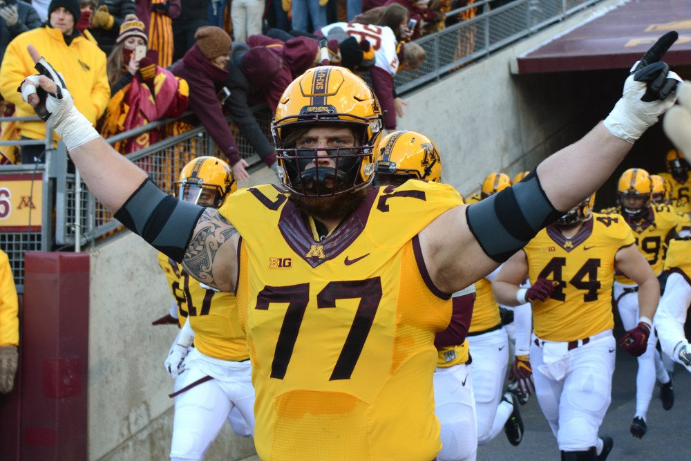Minnesota's Tyler Moore takes the field for the Gopher's last home game of the season against Northwestern. Minnesota won 29-12.