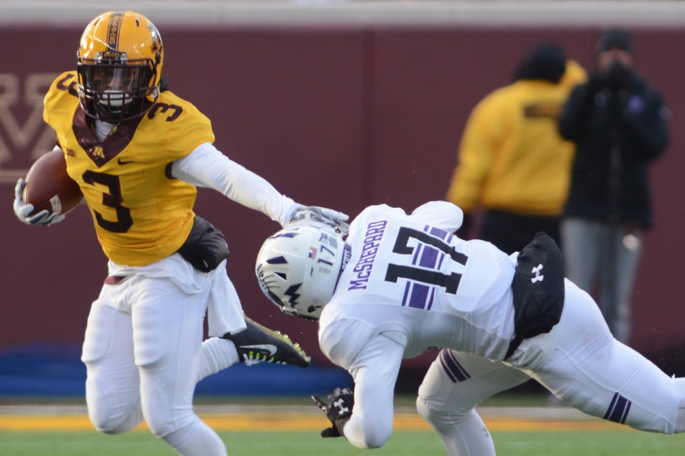 Minnesota defensive back KiAnte Hardin fends off Northwestern wide receiver Marcus McShepard at TCF Bank Stadium on Nov. 19, 2016. Minnesota won 29-12 over Northwestern at their last home game of the season.