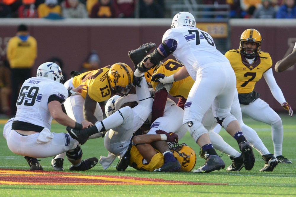 Minnesota wrestles for the ball against Northwestern at TCF Bank Stadium on Saturday, Nov. 19, 2016. Minnesota won 29-12 over Northwestern at their last home game of the season.