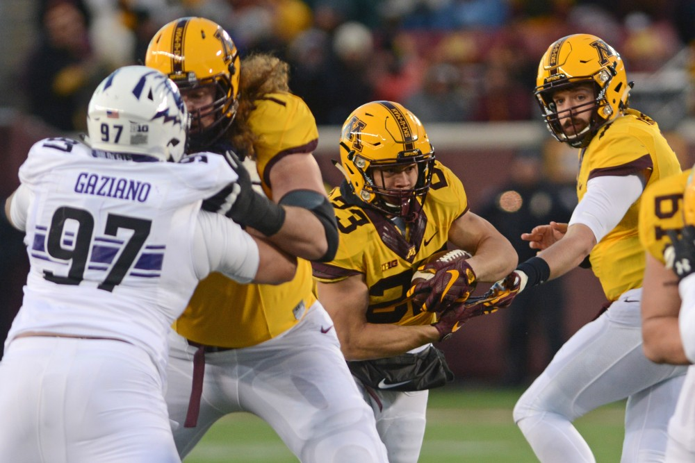 Minnesota quarterback Mitch Leidner hands the ball off to Shannon Brooks at TCF Bank Stadium on Saturday, Nov. 19, 2016. Minnesota won 29-12 over Northwestern at their last home game of the season.