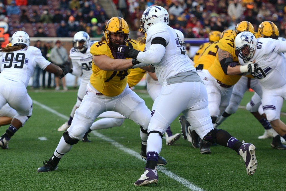 Minnesotas Nick Connelly engages with Northwesterns C.J. Robbins at TCF Bank Stadium on Saturday, Nov. 19, 2016. Minnesota won 29-12 over Northwestern at their last home game of the season.