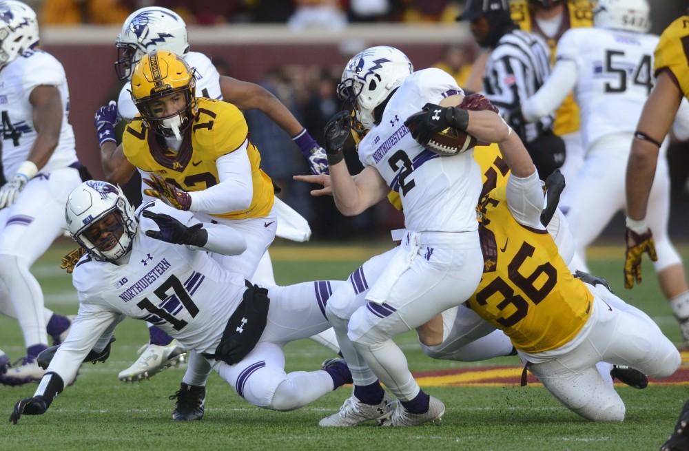 Sophomore linebacker Blake Cashman tackles Northwestern sophomore wide receiver Flynn Nagel at TCF Bank Stadium on Saturday, Nov. 19, 2016. The Gophers won 29-12.