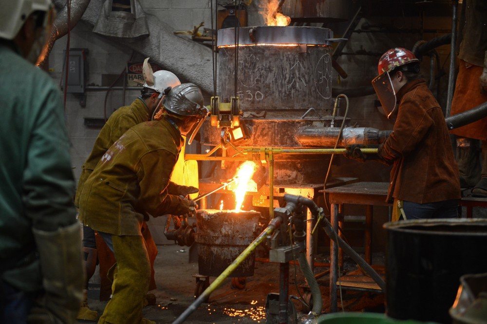 Participants in the 30th annual Iron Pour work in the foundry at the Regis Center for Art on Nov. 18, 2016.