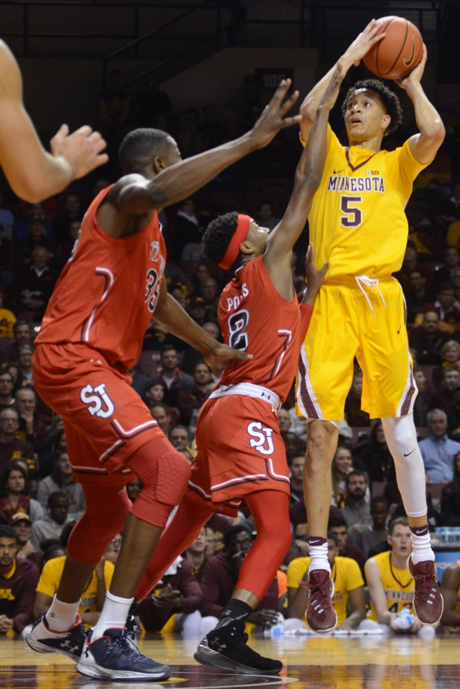 Freshman guard Amir Coffey attempts to score at Williams Arena on Friday, Nov. 18, 2016. The Gophers would win 92-86 against St. John's University.