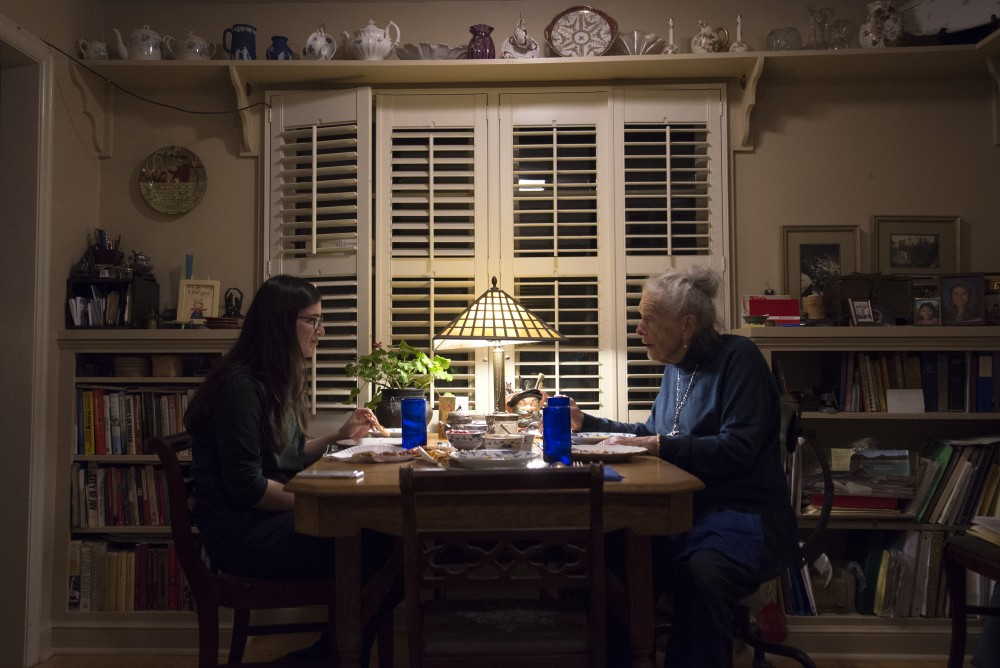 Julia Turnbow, left, and Mary Alice Kopf, right, converse over pizza and soup at Mary's home in Minneapolis on Saturday, Nov. 19, 2016.