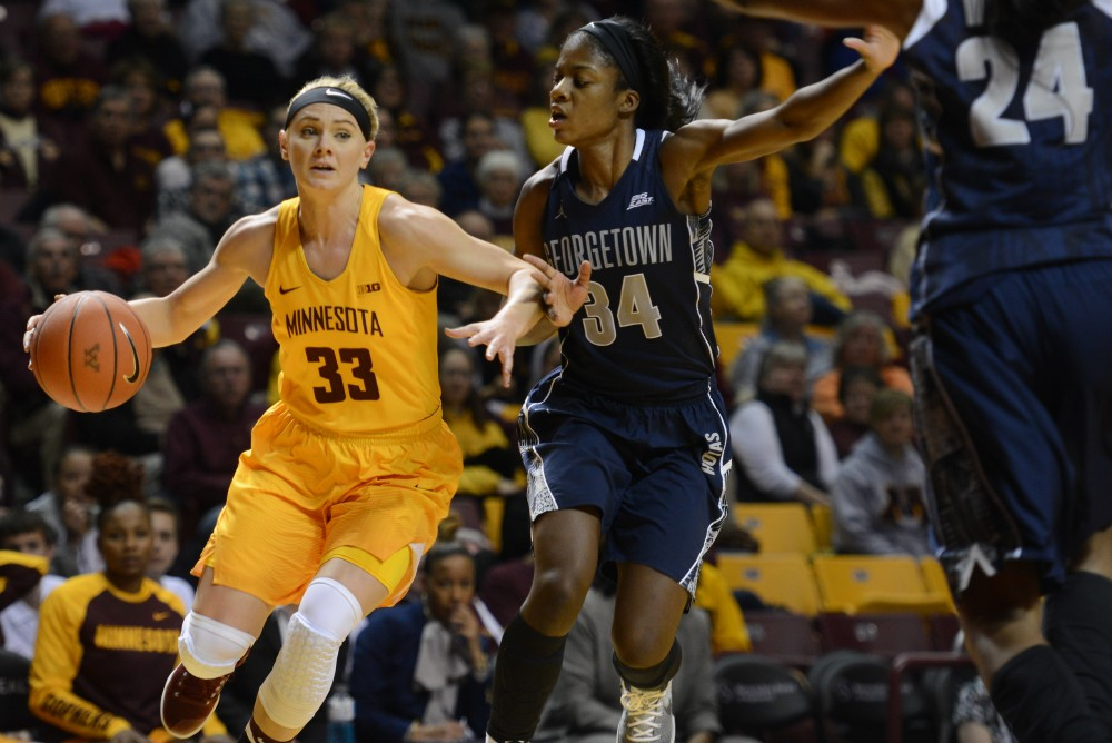 Minnesota's Carlie Wagner runs the ball against Georgetown's Dorothy Adomako at Williams Arena on Friday, Nov. 18, 2016. Minnesota won 68-60 over Georgetown.
