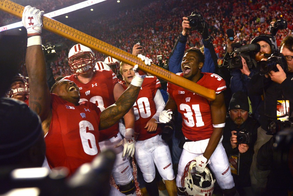 Wisconsin celebrates keeping the Paul Bunyan axe trophy after winning the game against Minnesota 31-17 at Camp Randall Stadium on Saturday, Nov. 26, 2016.