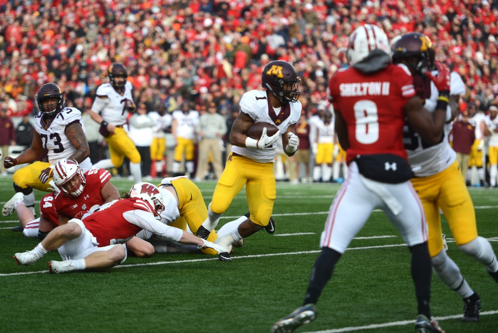 Minnesota running back Rodney Smith runs the ball against Wisconsin at Camp Randall Stadium in Madison, Wisconsin on Saturday, Nov. 26, 2016. Wisconsin won 31-17 over Minnesota.