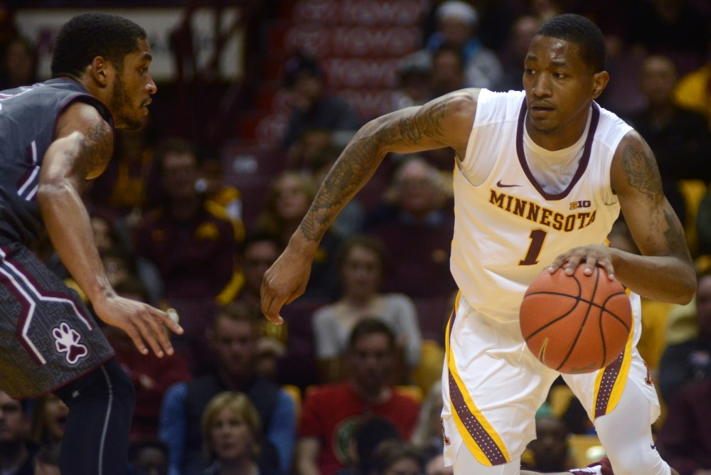 Gophers guard Dupree McBrayer handles the ball during Minnesotas game against Southern Illinois at Williams Arena on Nov. 26, 2016. The Gophers won 57-45.
