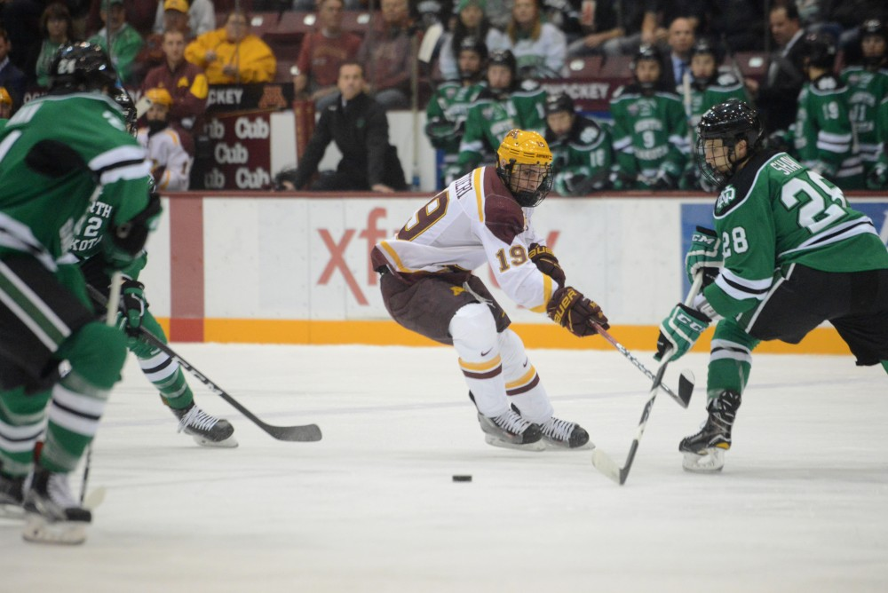 Senior forward Vinni Lettieri looks to steal the puck on Friday, Nov. 4, 2016 at Mariucci Arena. The Gophers tied 5-5 against the University of North Dakota.