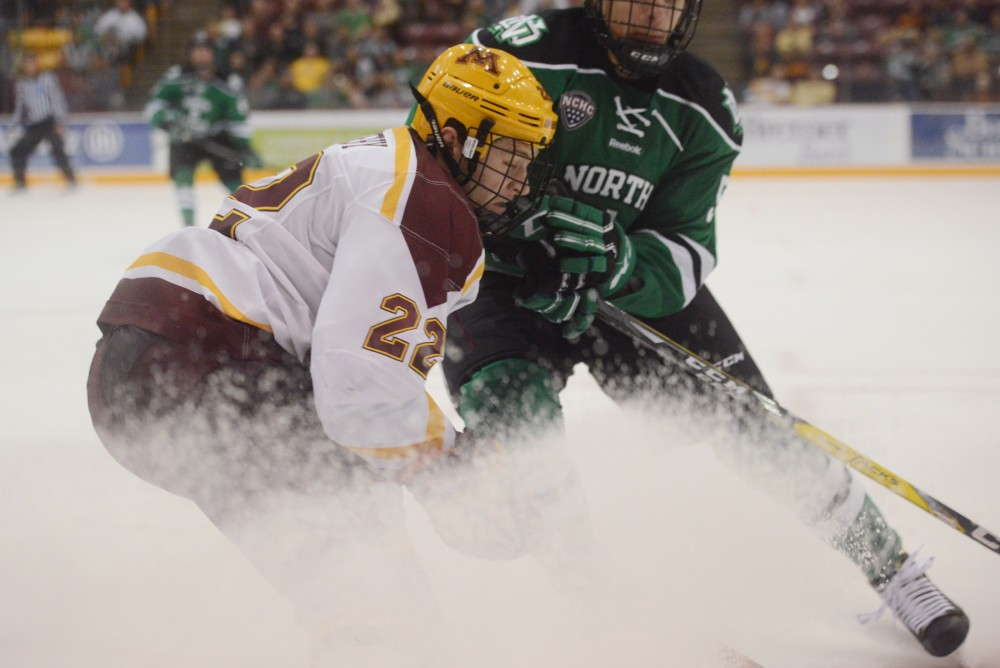 Sophmore forward Tyler Sheehy tries to steal the puck on Friday, Nov. 4, 2016 at Mariucci Arena. The Gophers tied 5-5 against the University of North Dakota.