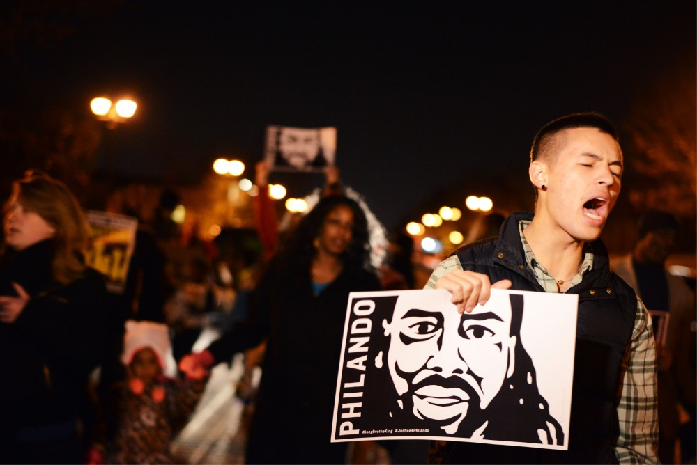 Robert Lin chants during a march for Philando Castile while walking down Selby Avenue in St. Paul on Wednesday, Nov. 16, 2016. The Twin Cities Coalition for Justice 4 Jamar organized a gathering at J.J. Hill Montessori Magnet School after Ramsey County attorney John Choi announced charges against St. Anthony police Officer Jeronimo Yanez for the death of Philando Castile.