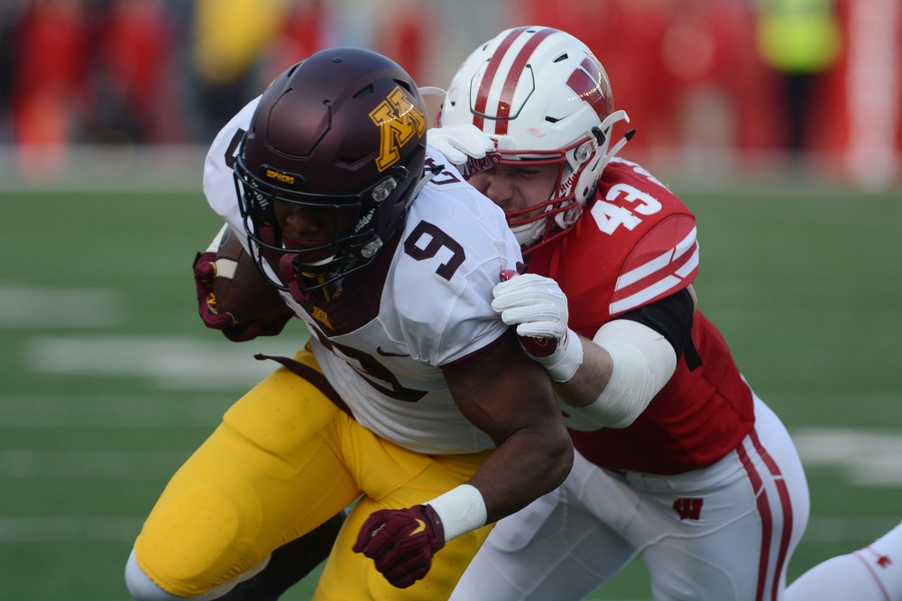 Wisconsin linebacker Ryan Connelly tackles Minnesota wide receiver Eric Carter at Camp Randall Stadium in Madison, Wis., on Saturday, Nov. 26, 2016. Wisconson won 31-17 over Minnesota.