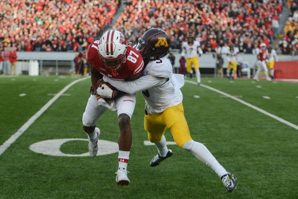 Minnesota defensive back KiAnte Hardin tackles Wisconsin Quintez Cephus at Camp Randall Stadium in Madison, Wis., on Saturday, Nov. 26, 2016. Wisconson won 31-17 over Minnesota.
