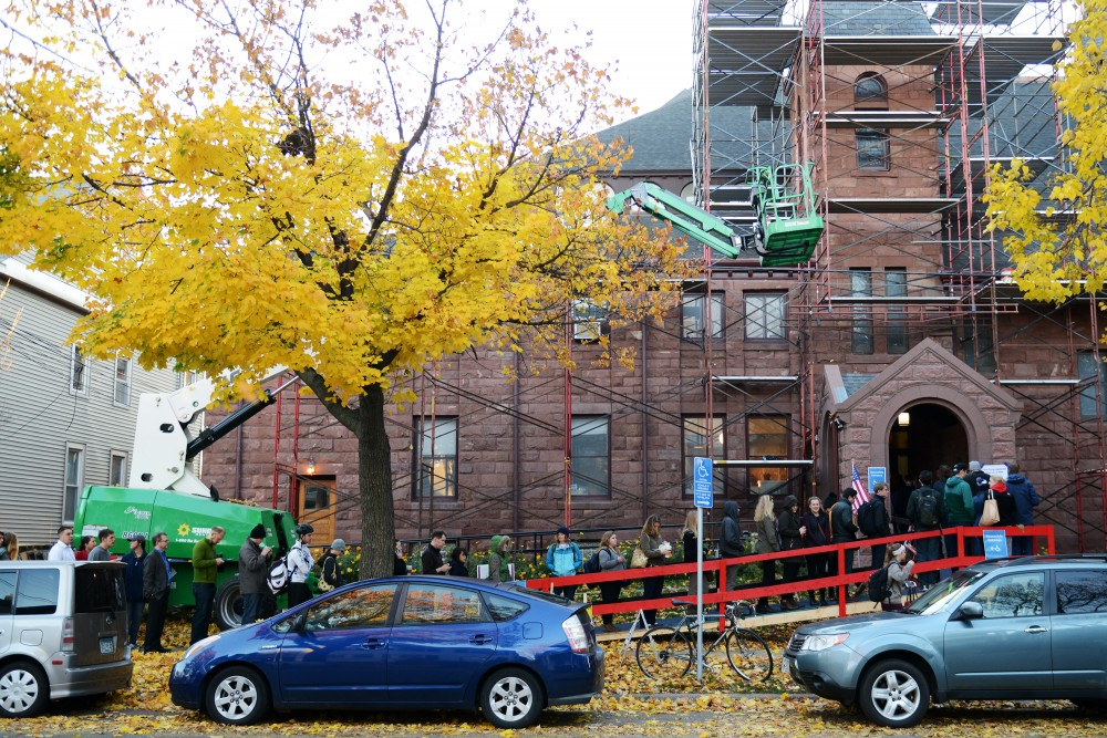 Voters line up outside of First Congressional Church in the Marcy Holmes neighborhood on Nov. 8, 2016. Polls opened at 7 a.m. and hundreds of voters came out early to cast their votes.