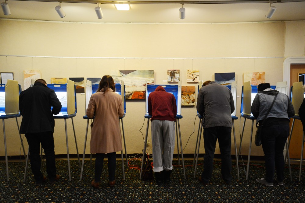 Voters fill out ballots at First Congressional Church in the Marcy Holmes neighborhood on the morning of Nov. 8, 2016.