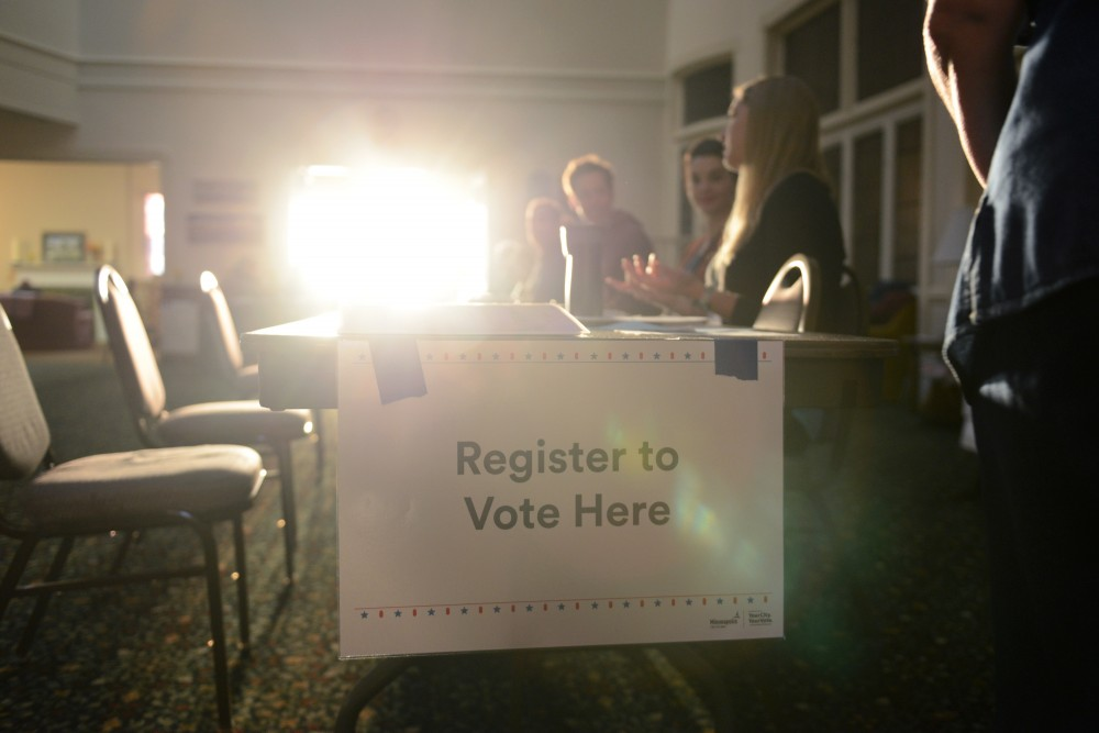 Volunteers wait to assist voters who still need to register at First Congressional Church in the Marcy Holmes neighborhood on Nov. 8, 2016. Polls opened at 7 a.m. and hundreds of voters came out early to cast their votes.