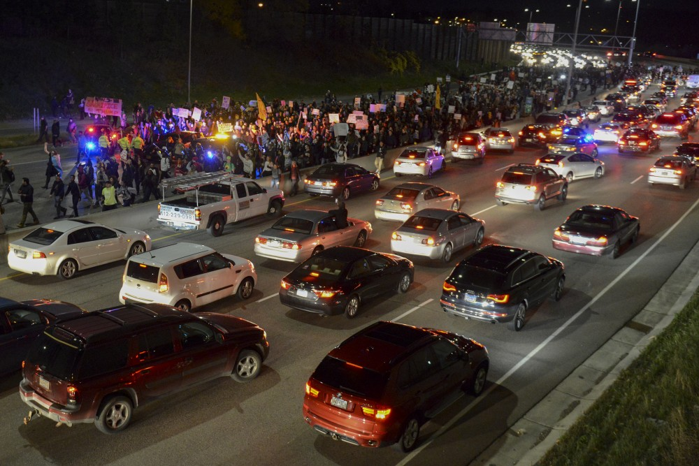 Protesters start marching on 94W during a protest against Donald Trump in Minneapolis on Nov. 10, 2016.