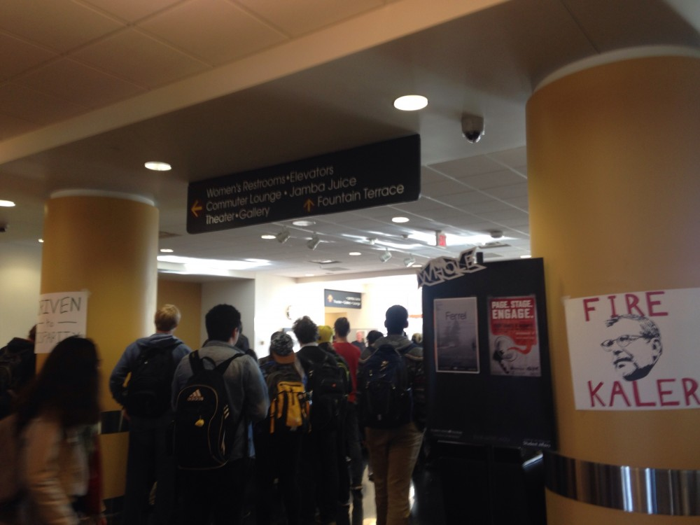 Students gather in Coffman Union Wednesday for a discussion on campus climate.