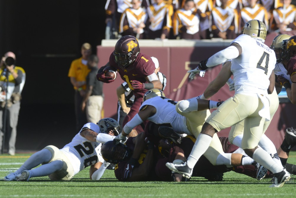 Gophers running back Rodney Smith runs the ball against the Boilermakers at TCF Bank Stadium on Nov. 5, 2016.