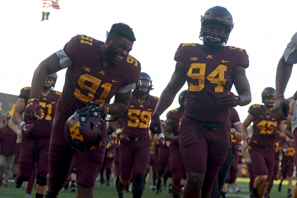 Defensive lineman Julien Kafo laughs while exiting the field for half time during the Gophers game against Purdue at TCF Bank Stadium on Nov. 5, 2016, where the Gophers won 44-31.