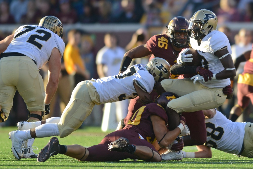 The Gophers fight Purdue for the ball during their game at TCF Bank Stadium on Nov. 5, 2016, where the Gophers won 44-31.