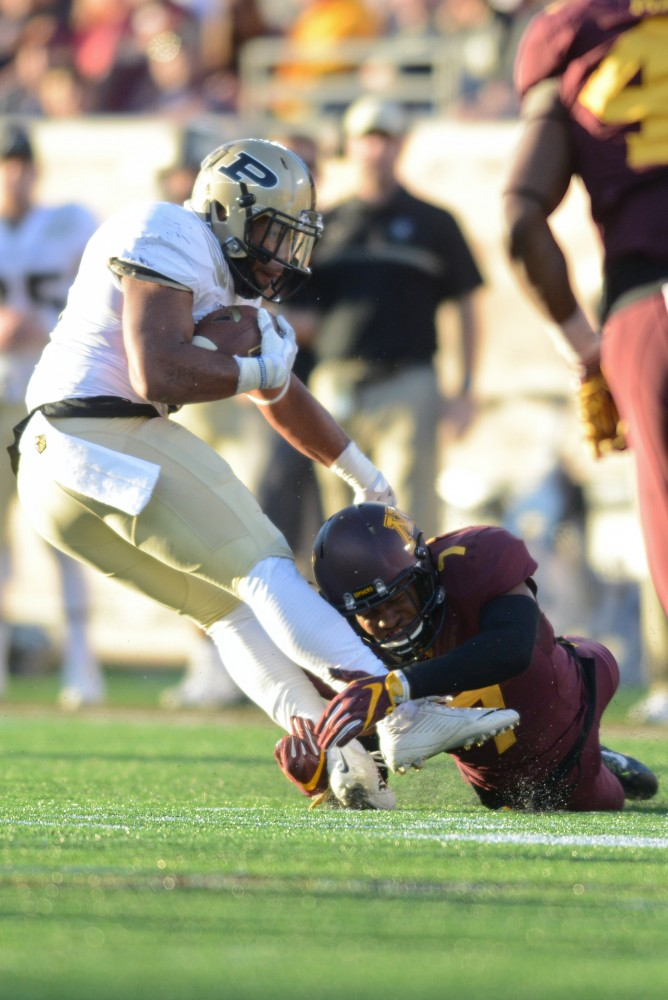 Gophers defensive back Damarius Travis tackles Purdue during their game at TCF Bank Stadium on Nov. 5, 2016, where the Gophers won 44-31.