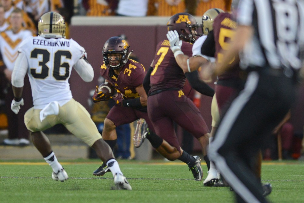 Gophers defensive back Kiondre Thomas runs the ball during the Gophers game against Purdue at TCF Bank Stadium on Nov. 5, 2016, where the Gophers won 44-31.
