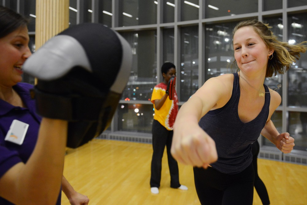 Junior Meghan Schwobe practices punching at a womens self defense seminar at the Recreation and Wellness Center on Nov. 30, 2016.