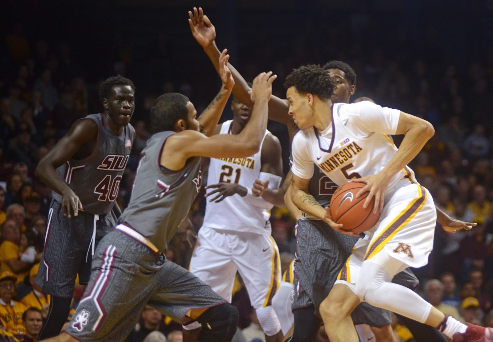 Gophers guard Amir Coffey handles the ball during Minnesotas game against Southern Illinois at Williams Arena on Nov. 26, 2016. The Gophers won 57-45.