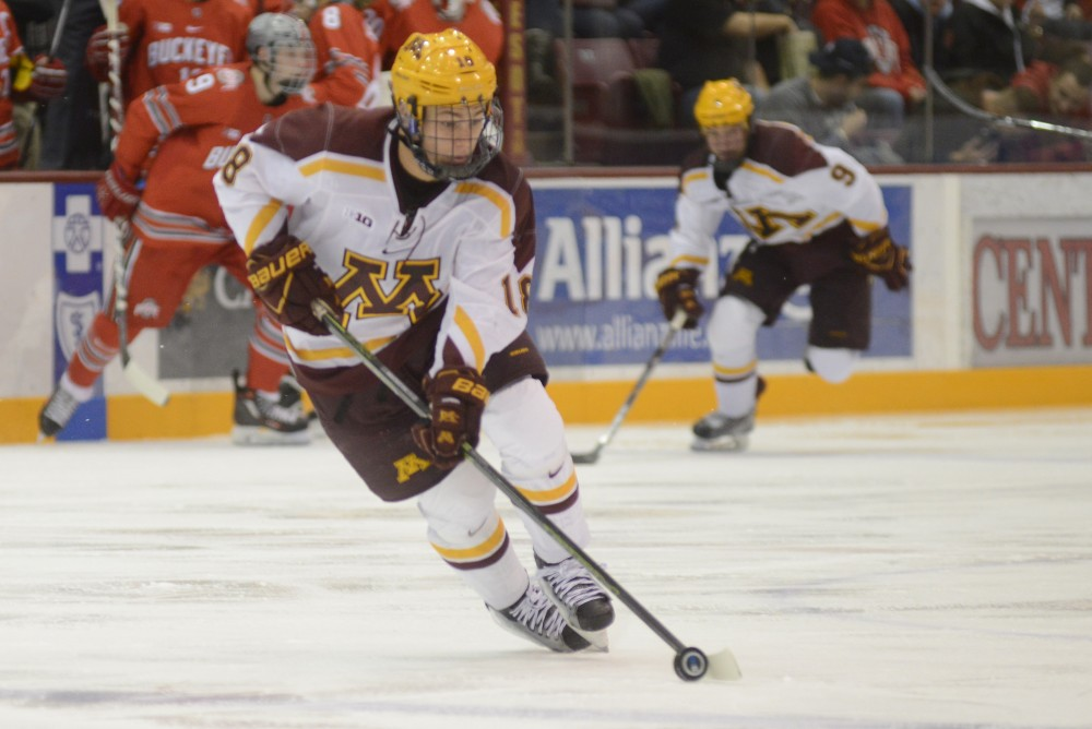 Gophers forward Leon Bristedt carries the puck into the Ohio State zone on Friday, Dec. 2, 2016 at Mariucci Arena.