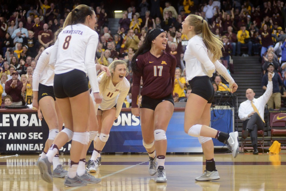 The Gophers celebrate after scoring a point on Friday, Dec. 2, 2016 at the Sports Pavilion. The Gophers won against the University of North Dakota.